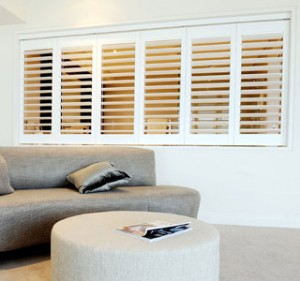 White shutters dividing kitchen and Living room