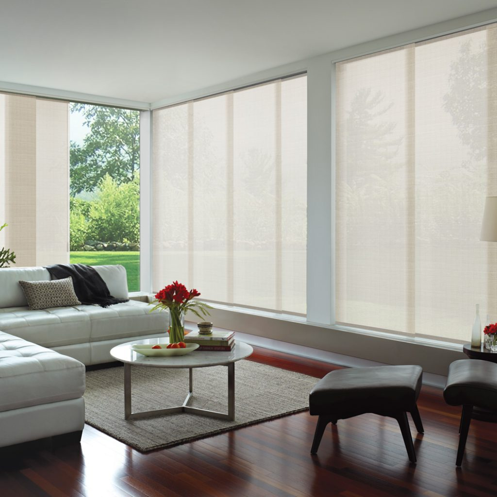 White Panel Glide venetian style blinds over large windows