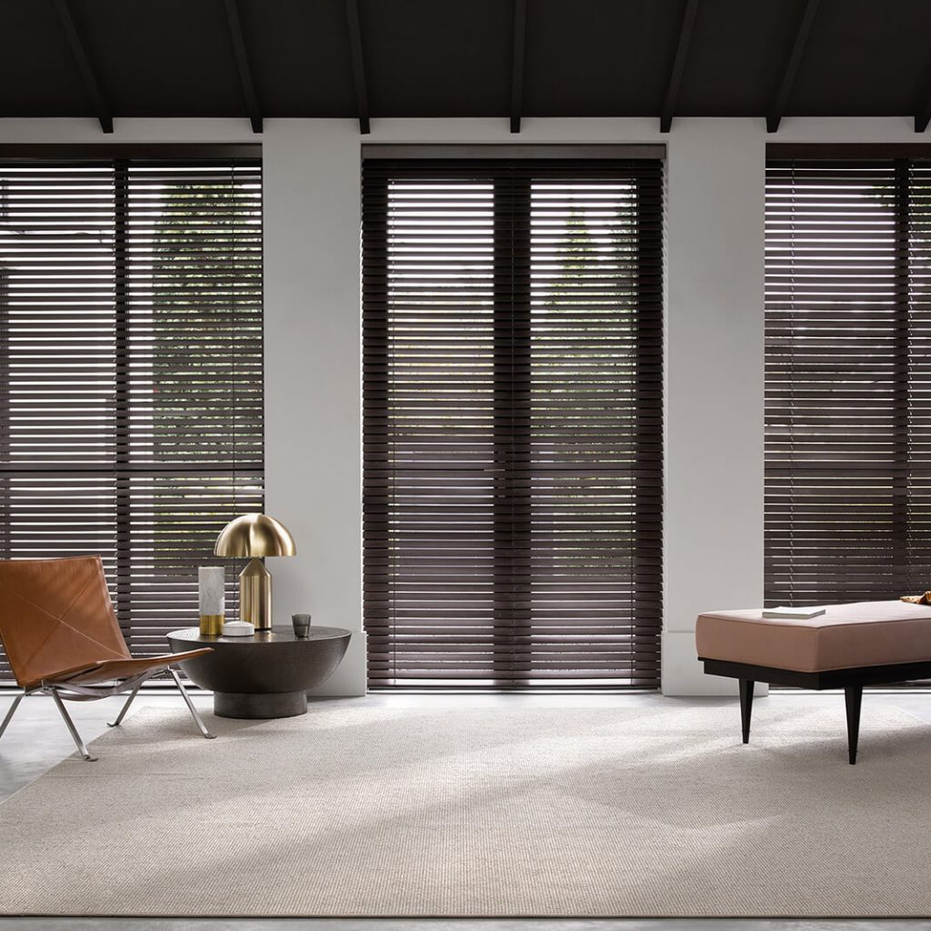 Dark timber venetians filtering light