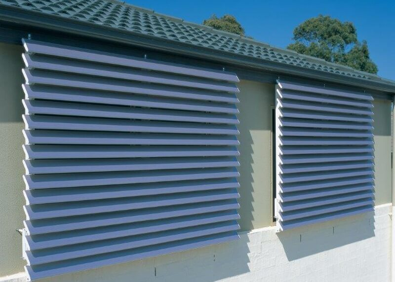 Outdoor shutters attached to side of house