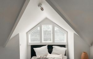 Unusual shape window with custom made plantation shutter