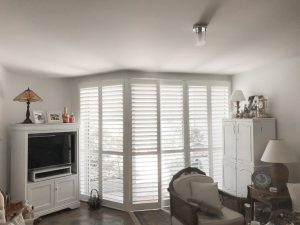 Corner Window with White Plantation Shutters
