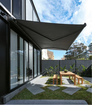 Rectractable pool shade over outdoor entertaining area on modern Melbourne home
