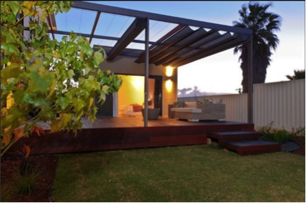 Photography showing dusk Melbourne sky and modern home with Retractable Patio Shade over an outdoor pergola