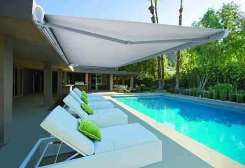 Retractable folding arm awning in white